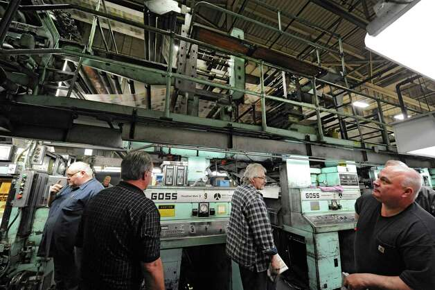 From left, pressmen Tom Wagoner, Al Veve, Robert Barron and Gerry Potter during the last run of the old Goss press at the Times Union on Monday, March 18, 2013 in Colonie, N.Y.  (Lori Van Buren / Times Union) Photo: Lori Van Buren