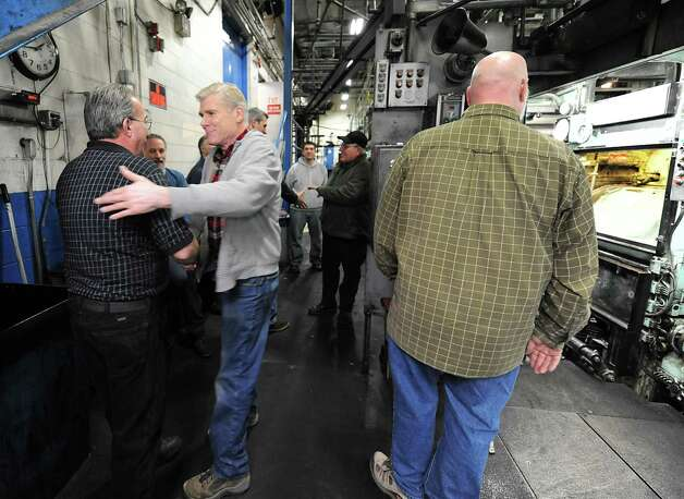 Pressmen say their goodbyes after the stop button was pressed for the final time on the old Goss press at the Times Union on Monday, March 18, 2013 in Colonie, N.Y.  (Lori Van Buren / Times Union) Photo: Lori Van Buren
