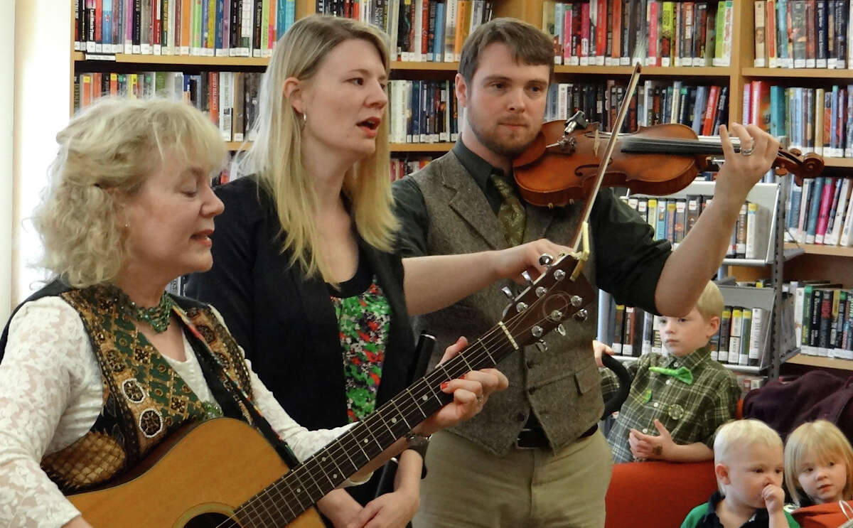 Sally and Damian Connelly, and Sally's mother, Kathleen McCann Tessler, left, perform traditional Irish songs at Fairfield Public Library on Sunday. FAIRFIELD CITIZEN, CT 3/17/13