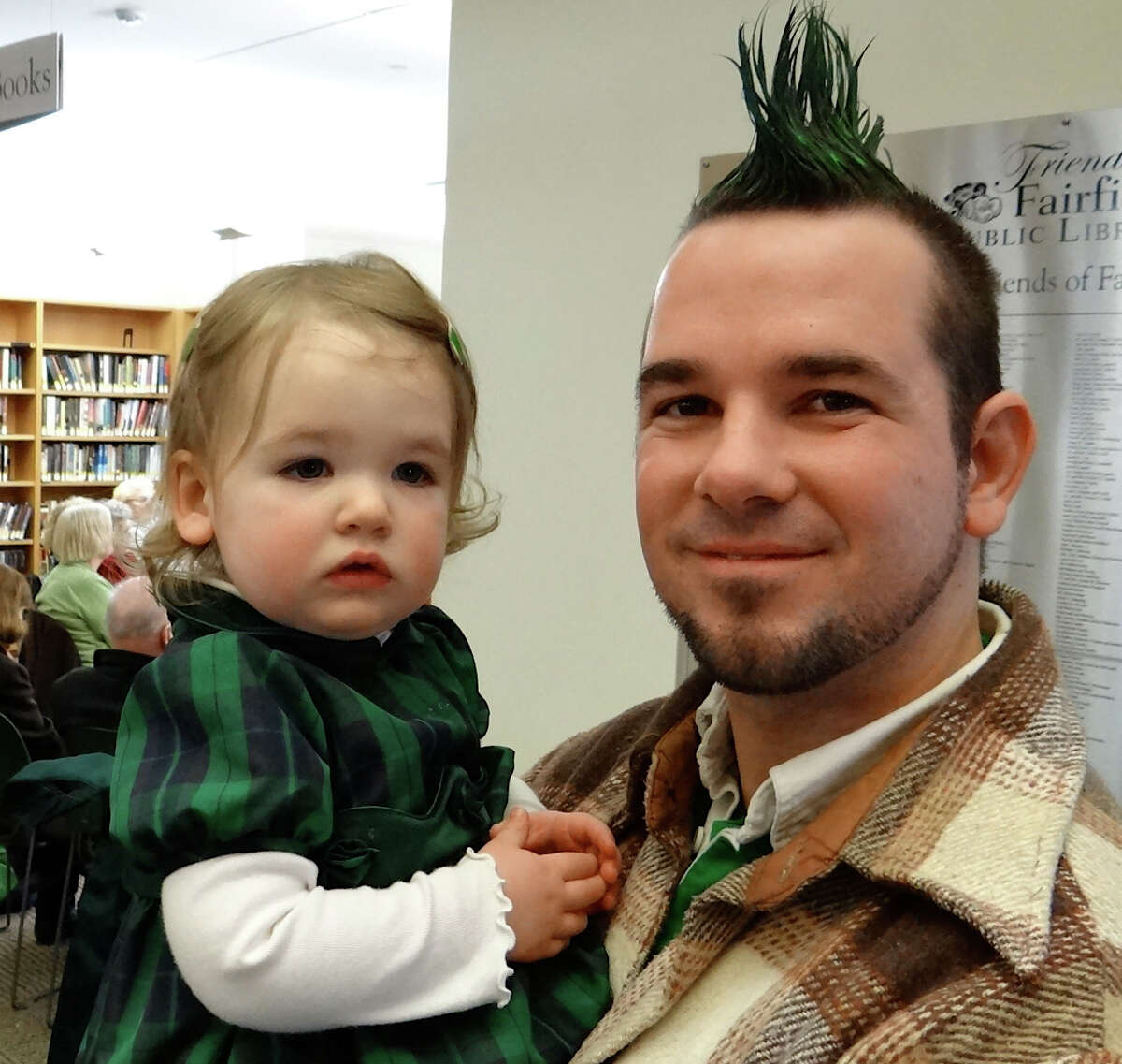 Liam Thidemann of Fairfield and daughter Beibhinn at a St. Patrick's Day musical program by Sally and Damian Connolly at ther Fairfield Public Library. FAIRFIELD CITIZEN, CT 3/17/13