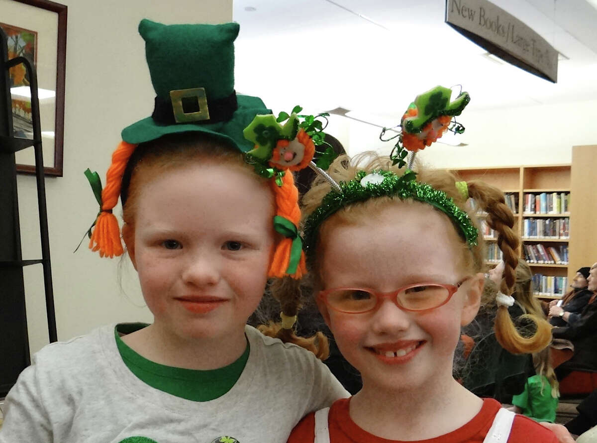 Brigid and Colleen Halliday, 9 and 7, of Fairfield at a St. Patrick's Day concert in the Fairfield Public Library. FAIRFIELD CITIZEN, CT 3/17/13