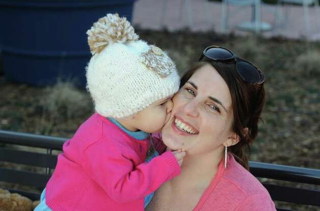 Amber V. Roussel, 31, with her now 3-year-old daughter Emmie Claire Roussel. Photo: Facebook