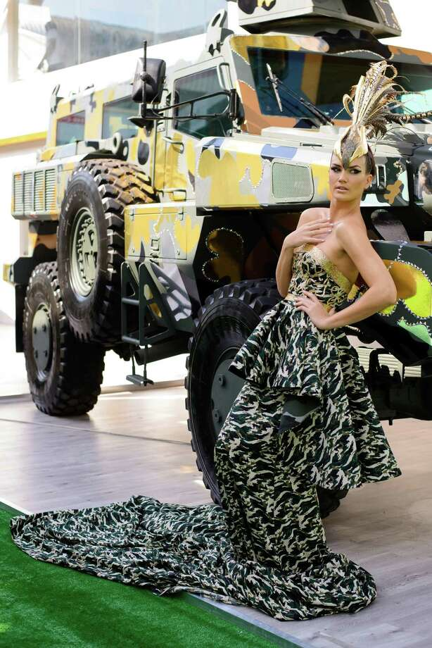 The world's toughest vehicle, Paramount Group's 16 ton Marauder, has received a couture fashion makeover in response to growing public interest for a consumer friendly version. The vehicle was covered in Swarovski crystals and gold, chrome and bronze camouflage, and accompanied by model in matching ballgown. The makeover was undertaken by Gavin Rajah, couture designer to the stars including Beyonce and Cameron Diaz. These photos were taken at the Abu Dhabi Exhibition Centre on Feb. 17. Photo: Martin Doyle, Martin Doyle/Getty