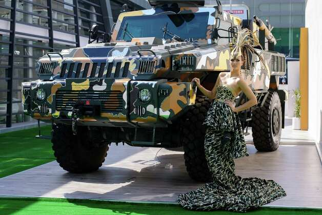 The world's toughest vehicle, Paramount Group's 16 ton Marauder, has received a couture fashion makeover in response to growing public interest for a consumer friendly version. The vehicle was covered in Swarovski crystals and gold, chrome and bronze camouflage, and accompanied by model in matching ballgown. The makeover was undertaken by Gavin Rajah, couture designer to the stars including Beyonce and Cameron Diaz. Photo: Martin Doyle, Martin Doyle/Getty