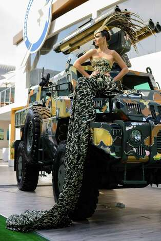 The world's toughest vehicle, Paramount Group's 16 ton Marauder, has received a couture fashion makeover in response to growing public interest for a consumer friendly version. The vehicle was covered in Swarovski crystals and gold, chrome and bronze camouflage, and accompanied by model in matching ballgown. The makeover was undertaken by Gavin Rajah, couture designer to the stars including Beyonce and Cameron Diaz. Photo: Martin Doyle, Martin Doyle/Getty / 2013 Getty Images