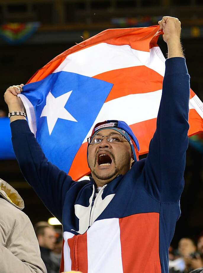 A fan of Team Puerto Rico waves the Puerto Rican Flag while watching the game against Team Japan during the World Baseball Classic Semifinals at AT&T Park on March 17, 2013 in San Francisco, California. Team Puerto Rico won the game 3-1. Photo: Thearon W. Henderson, Getty Images