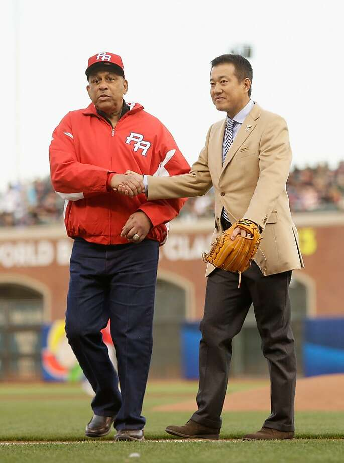 Orlando Cepeda shakes hands with Tatsunori Hara after Hara threw out the ceremonial first pitch before the semifinals of the World Baseball Classic at AT&T Park on March 17, 2013 in San Francisco, California.  Photo: Ezra Shaw, Getty Images