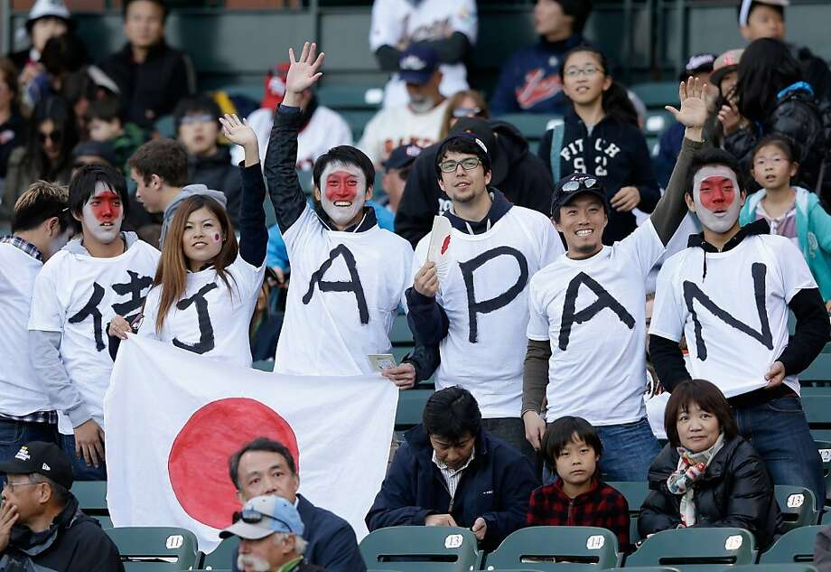 Japanese fans cheer on their team before their game against Puerto Rico in the semifinals of the World Baseball Classic at AT&T Park on March 17, 2013 in San Francisco, California. Photo: Ezra Shaw, Getty Images
