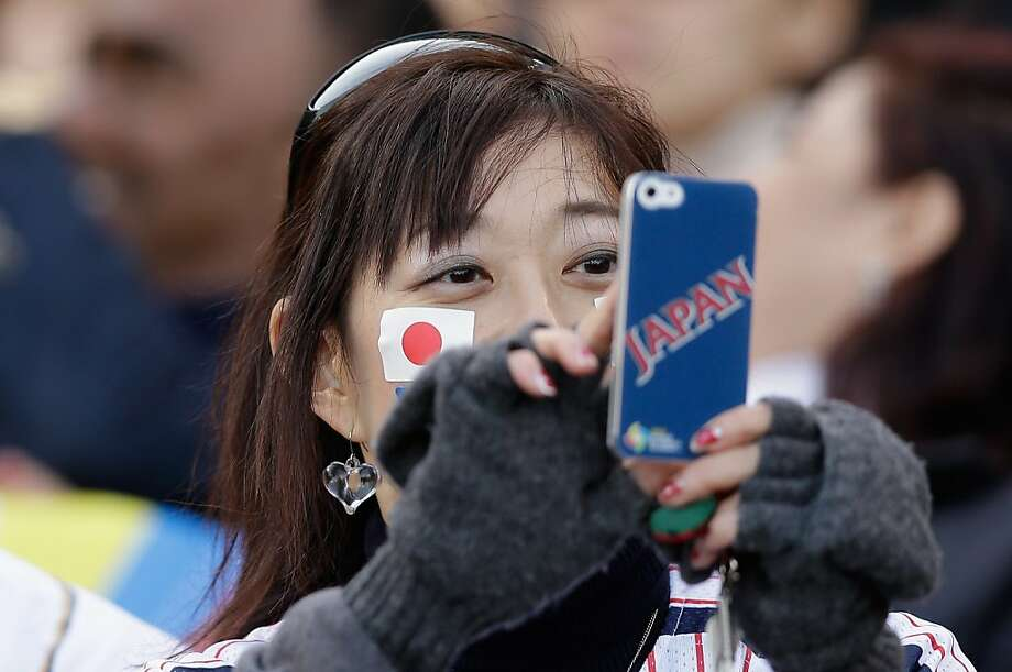 A Japanese fan takes a picture before their game against Puerto Rico in the semifinals of the World Baseball Classic at AT&T Park on March 17, 2013 in San Francisco, California. Photo: Ezra Shaw, Getty Images