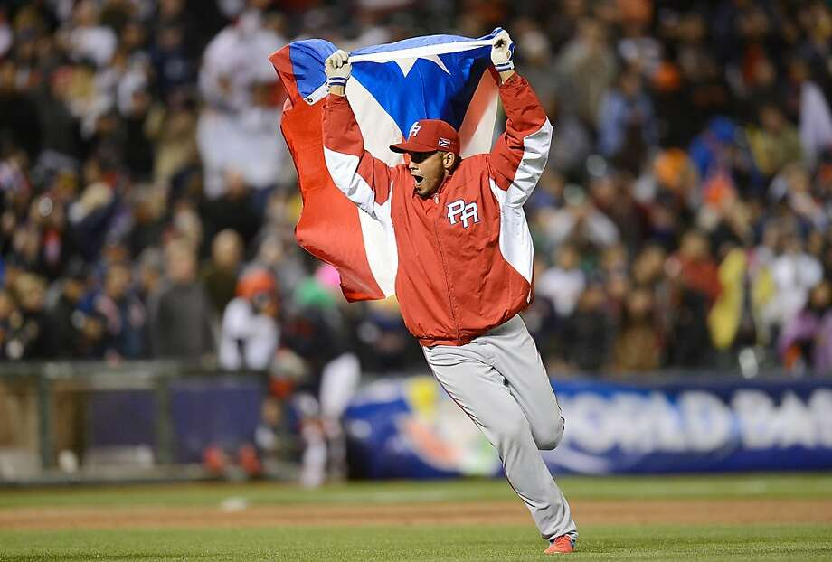 Hiram Burgos of Team Puerto Rico celebrates waving the flag of Puerto Rico after his team defeated Team Japan 3 to 1 in the World Baseball Classic Semifinals at AT&T Park on March 17, 2013 in San Francisco, California.  Photo: Thearon W. Henderson, Getty Images