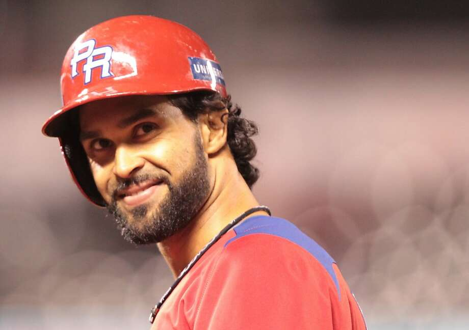 Puerto Rico's Angel Pagan smiles at the fans after hitting a single against Japan in the World Baseball Classic semi-final game in San Francisco on Sunday, March 17, 2013. Photo: Mathew Sumner, Special To The Chronicle