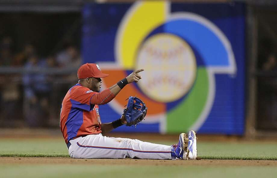 Puerto Rico's Irving Falu reacts after throwing out Japan's Yoshio Itoi out at first base during the fifth inning of a semifinal game of the World Baseball Classic in San Francisco, Sunday, March 17, 2013. Photo: Ben Margot, Associated Press