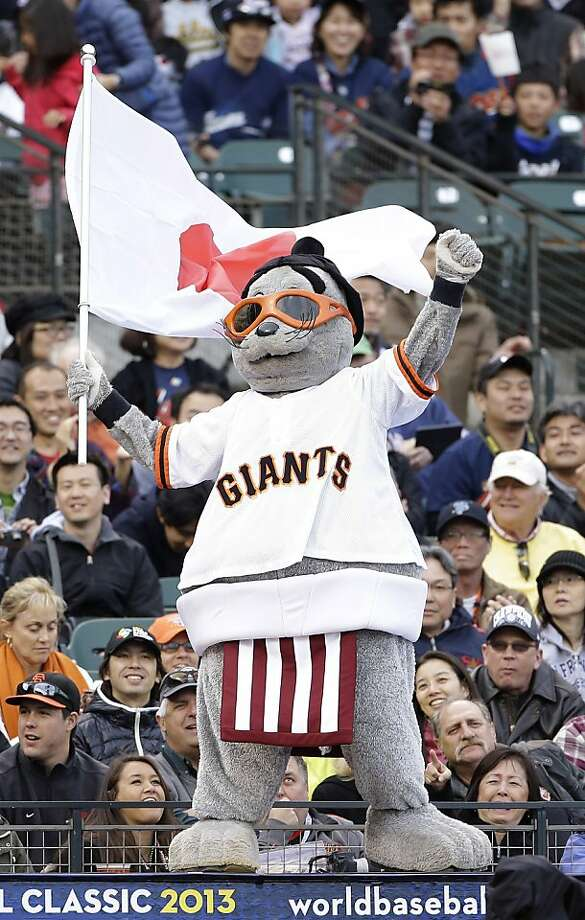 San Francisco Giants mascot Lou Seal waves a Japanese flag during a semifinal game of the World Baseball Classic between Japan and Puerto Rico in San Francisco, Sunday, March 17, 2013. Photo: Eric Risberg, Associated Press