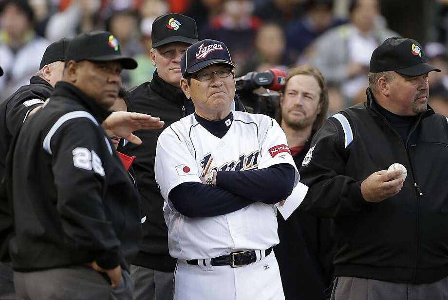 Koji Yamamoto meets with umpires before a semifinal game of the World Baseball Classic against Puerto Rico in San Francisco, Sunday, March 17, 2013. Photo: Eric Risberg, Associated Press