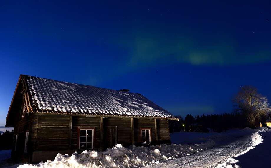 The Aurora Borealis bright up the sky at twilight on March 17, 2013 between the towns of Are and Ostersund, Sweden. AFP PHOTO/JONATHAN NACKSTRAND        (Photo credit should read JONATHAN NACKSTRAND/AFP/Getty Images)