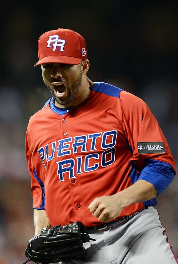 Pitcher J.C. Romero of Team Puerto Rico reacts after getting Shinnosuke Abe #10 of Team Japan to ground out to second base for the third out of the bottom of the eighth inning during the World Baseball Classic Semifinals at AT&T Park on March 17, 2013 in San Francisco. Photo: Thearon W. Henderson, Getty Images