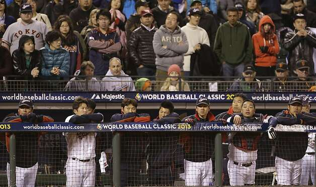 Japan players stand in the dugout during the ninth inning of a semifinal game of the World Baseball Classic against Puerto Rico in San Francisco, Sunday, March 17, 2013. Photo: Eric Risberg, Associated Press