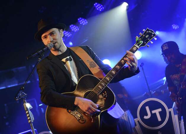 Justin Timberlake plays guitar? Anything can happen at SXSW.  Photo: Jason Kempin, Getty Images For Myspace / 2013 Getty Images