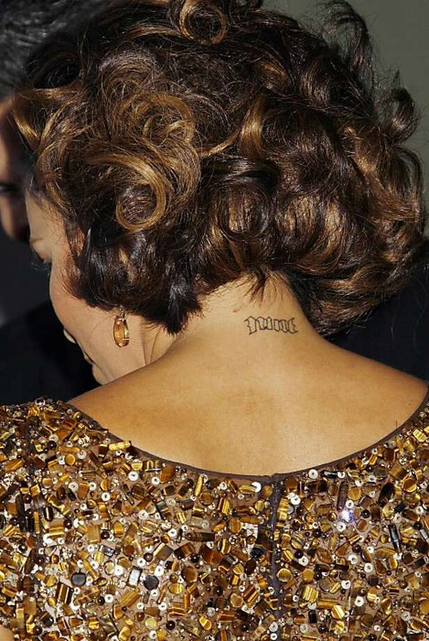 Eva Longoria has this delicate ink on the back of her neck. The Desperate Housewives star has several other tattoos, including a star on her wrist and cross on her lower back.