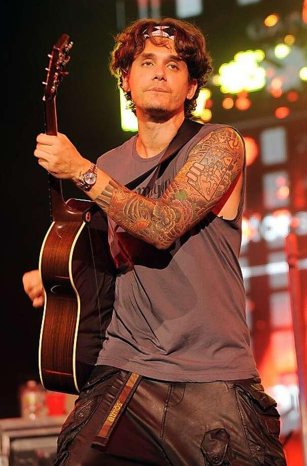 Rocker John Mayer has a full sleeve of tattoos.