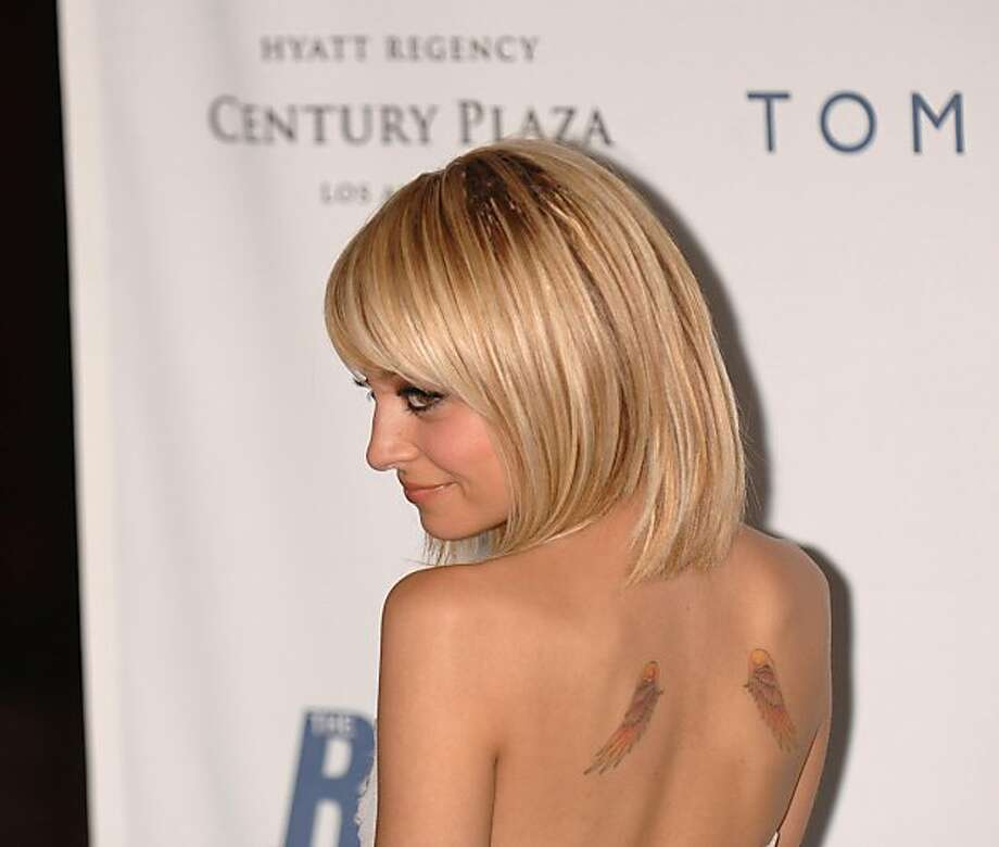 Nicole Richie has delicate angel wings on her shoulder blades, as well as a famous rosary tattoo on her ankle.
