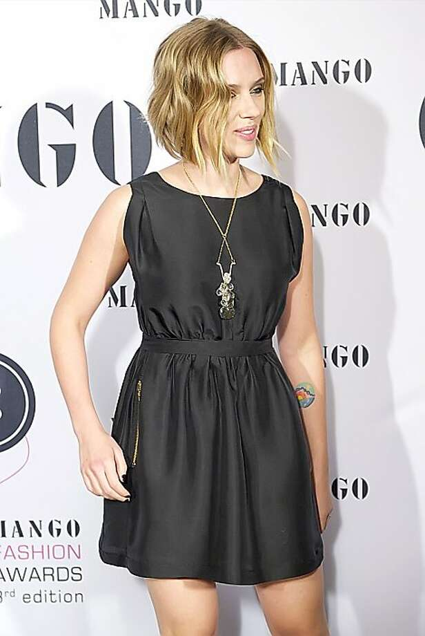 Scarlett Johansson has a colorful sunset on her inner forearm.