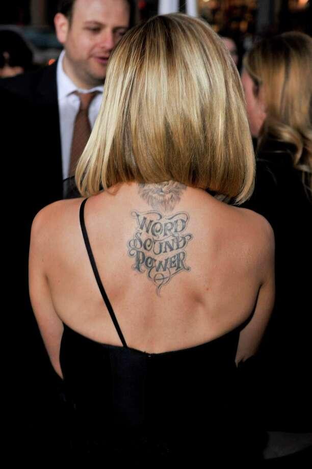 Mena Suvari has this ferocious tattoo on her upper back. Photo: Mandatory Credit: Apega/WENN.com