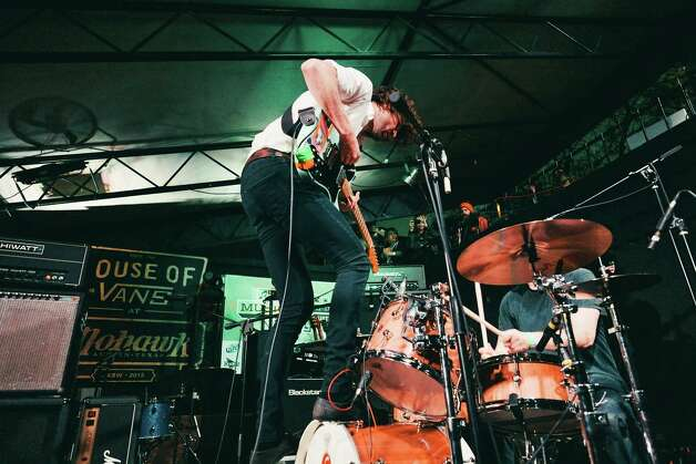The drum set is not a ladder, but Japandroids don't mind.  Photo: Butchershop Creative