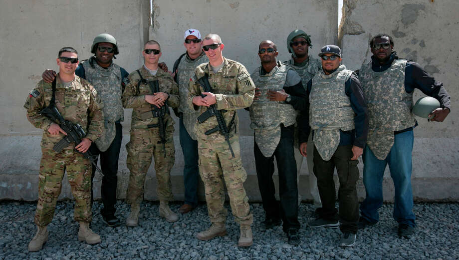 Texans defensive end J.J. watt poses for a picture with service members stationed in the Middle East along with fellow NFL players DaQwell Jackson, Champ Bailey, Von Miller, Steve Smith and Davin Joseph. Photo: FRED GREAVES / USO