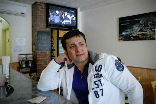 Estevan Cubillos sits at the counter of Ecuadorian restaurant El Idolo in  Norwalk, Conn. on Friday March 15, 2013. Photo: Dru Nadler / Stamford Advocate Freelance