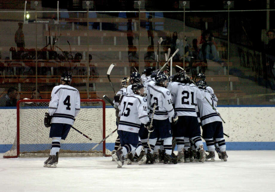 The Staples-Weston-Shelton boys hockey team celebrates after beating Windsor-East Granby-Avon in the Division III state semifinals at Yale's Ingalls Rink in March 2011. Staples is one of a growing number of co-op hockey teams in Connecticut. Photo: Christian Abraham, ST / Connecticut Post