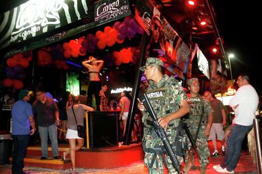 Mexican navy marines patrol the nightclub section as Spring Break revelers enjoy in the resort city of Cancun, Mexico. (AP Photo/Israel Leal) Photo: Israel Leal, AP / AP