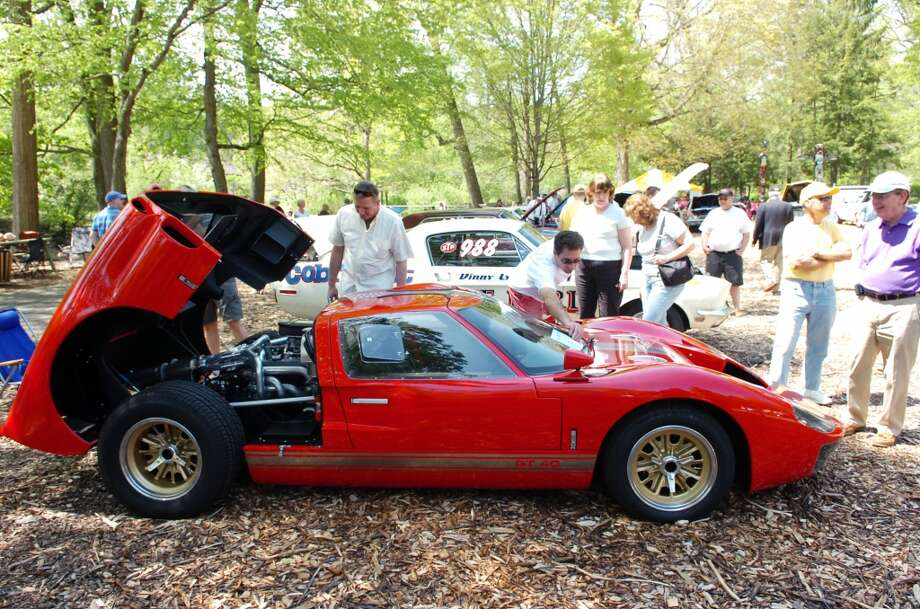 Jim Friedman adjusts the tag on the windshield of his 1966 Ford GT40 Mark II as it draws attention at the Stamford Museum's & Nature Center 7th Annual Model Ts to Mustangs show. The SM&NC is putting out a call for classic cars for its next Model Ts to Mustangs show on Saturday, May 8.