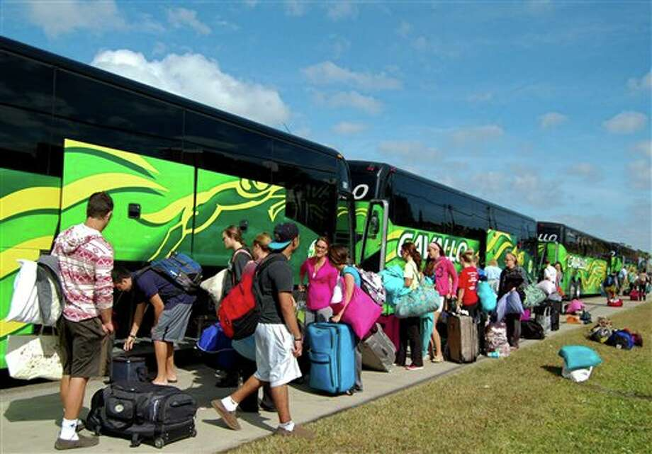 Spring breakers load their luggage onto charter busses to get ready to head back home to Chicago, Illinois on Friday, March 15, 2013 in South Padre Island, Texas. Photo: Martha Hernandez, AP / The Brownsville Herald