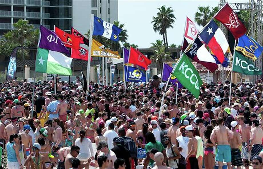 Flags of different universities and organizations were on display during spring break on Tuesday, Mar. 12, 2013 at South Padre Island, Texas. Photo: Paul Chouy, AP / The Brownsville Herald