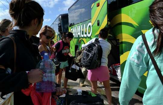 Spring breakers load their luggage onto charter busses to get ready to head back home to Chicago, Illinois on Friday, March 15, 2013 in South Padre Island, Texas. Photo: Christian Rodriguez, AP / The Brownsville Herald
