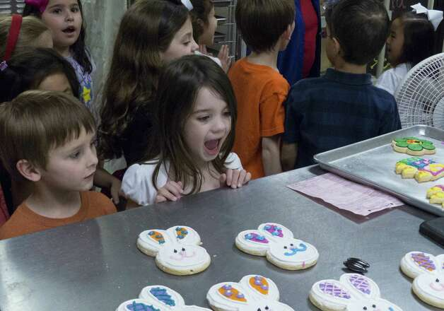 Genna Dieges reacts to the sight of decorated cookies at a birthday party for Liliana Jin Gomez at Cookie Party Time. Photo: Billy Calzada / San Antonio Express-News
