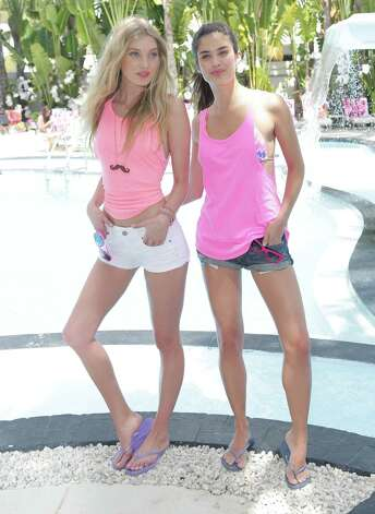 Elsa Hosk and Sara Sampaio are seen at the Victoria's Secret PINK Ultimate Spring Break Dance Party on March 13, 2013 in Miami Beach, Fla. Photo: Alexander Tamargo, Getty Images / 2013 Alexander Tamargo