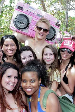 Alexander Ludwig poses backstage with fans at the Victoria's Secret PINK Ultimate Spring Break Dance Party on March 13, 2013 in Miami Beach, Fla. (Photo by John Parra/WireImage) Photo: John Parra, Getty Images / 2013 John Parra