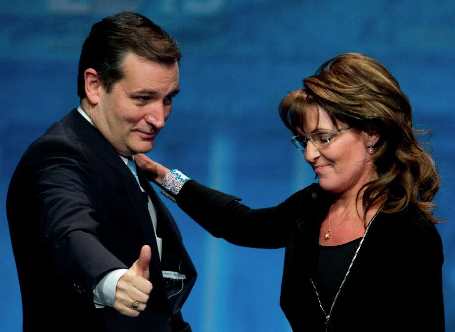 Sen. Ted Cruz, R-Texas, left, greets Former Alaska Gov. Sarah Palin after introducing her at the 40th annual Conservative Political Action Conference in National Harbor, Md., Saturday, March 16, 2013. Diehard activists at the three-day conference are already picking favorites in what could be a crowded Republican presidential primary in 2016. (AP Photo/Carolyn Kaster) Photo: Carolyn Kaster, Associated Press / AP