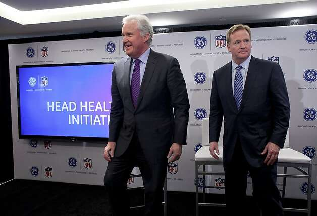 Jeff Immelt (left), chairman and CEO of General Electric, and Roger Goodell, commissioner of the National Football League (NFL), attend a news conference March 11, 2013 New York City. The two were on hand to introduce an initiative and research program to study concussions in an effort to improve the safety of professional football players. Photo: Allison Joyce, Getty Images