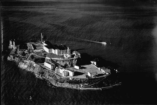 Alcatraz Island with small boat in back of the prison on Jan 18, 1952. Photo: Barney Peterson, The Chronicle