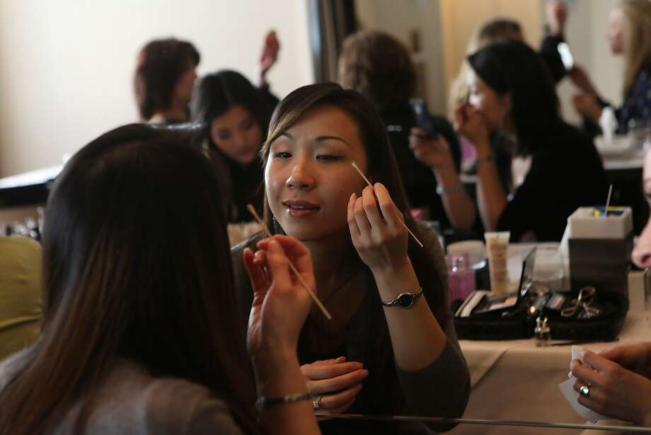Customer Cathy Tiet from the east bay applies shadow during a Trish McEvoy product demonstration in the rotunda of Neiman Marcus in San Francisco, Calif., on Wednesday, February 27, 2013. Photo: Liz Hafalia, The Chronicle
