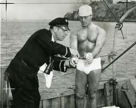 Jack LaLanne swims from Alcatraz to Fisherman's Wharf in handcuffs on July 9, 1955. Photo: Gordon Peters