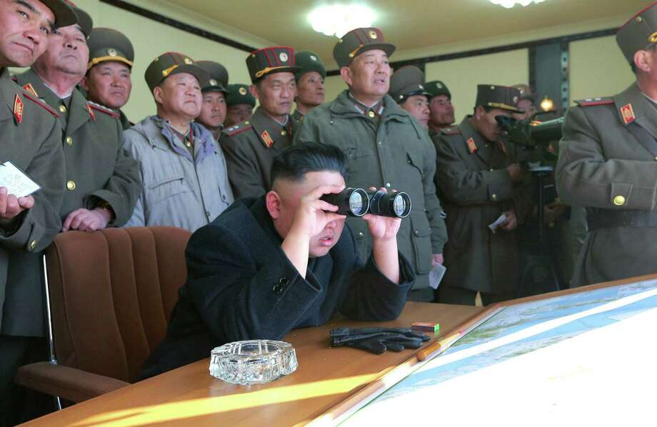 Rehearsing, but for what? In an undated photo by the Korean Central News Agency, North Korean leader Kim Jong Un peers at live ammunition firing drills.  The Kim dictatorship has revoked the Korean War armistice. What's next? Photo: Korean Central News Agency, Associated Press