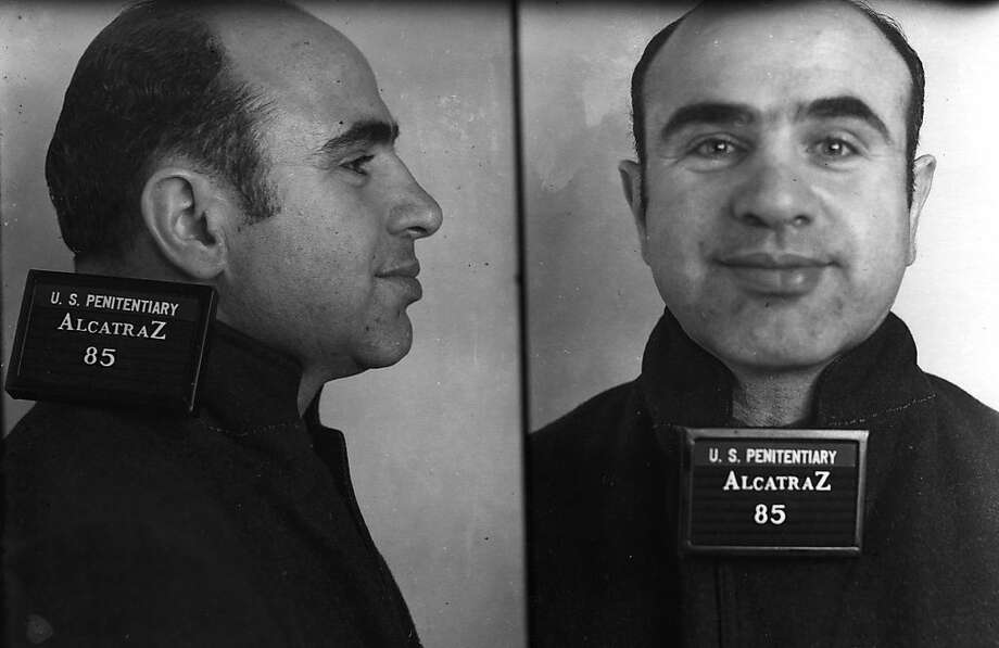 Gangster Al Capone was one of the most famous inmates at Alcatraz.  He served his term there from 1934-39.  Capone was almost stabbed in the neck by inmate James Lucas, a bank robber from Texas, after he cut a line of prisoners waiting to get haircuts. Photo: Bureau Of Prisons, University Of California Press