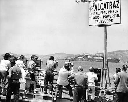 People view Alcatraz through powerful telescopes on June 16, 1962. Photo: Joe Rosenthal, The Chronicle