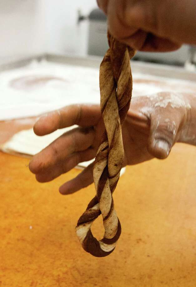 Carlos Fuentes works on the art of the twist. Photo: J. Patric Schneider, For The Chronicle / © 2013 Houston Chronicle