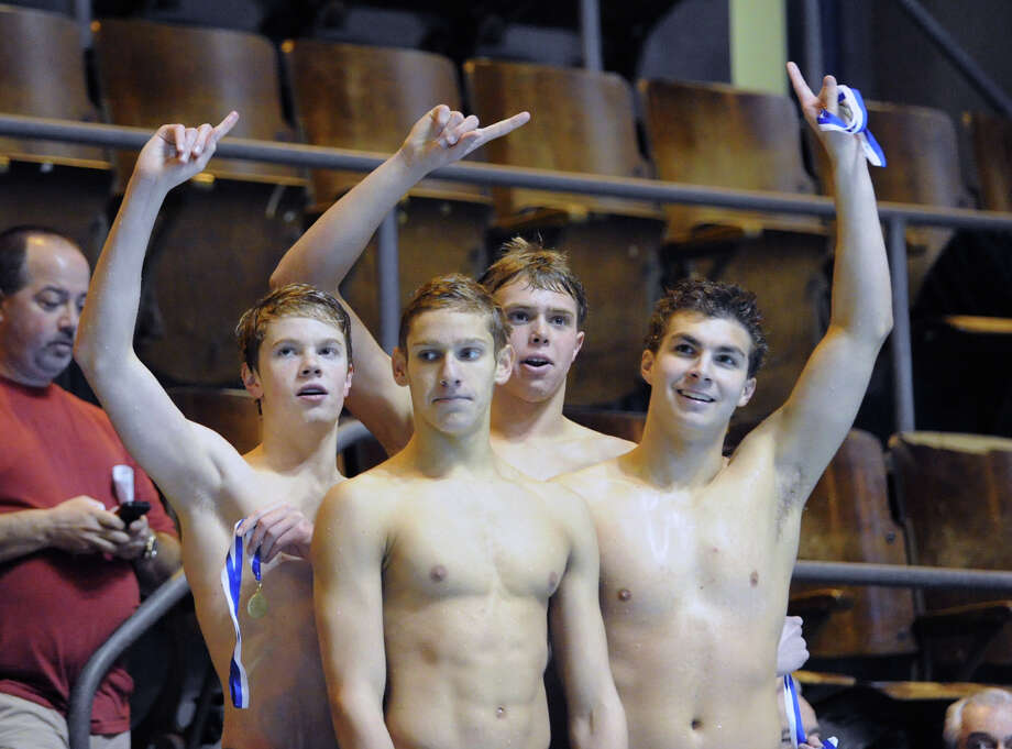 From left, Thomas Dillinger, Alex Lewis, Ben Wurst and Matthew Fraser, members of the Greenwich High School 400 yard freestyle relay, stand atop the winner's podium after they came in first in the event during the State Open swimming championships that Greenwich won at Yale University, New Haven, Conn., Saturday, March 16, 2013. Photo: Bob Luckey / Greenwich Time