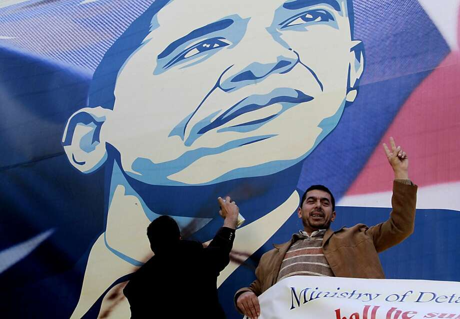 Palestinian activists vandalize a poster of President Obama in the West Bank city of Bethlehem. Obama's visit to the Middle East will be the first overseas trip of his second term. Photo: Nasser Shiyoukhi, Associated Press